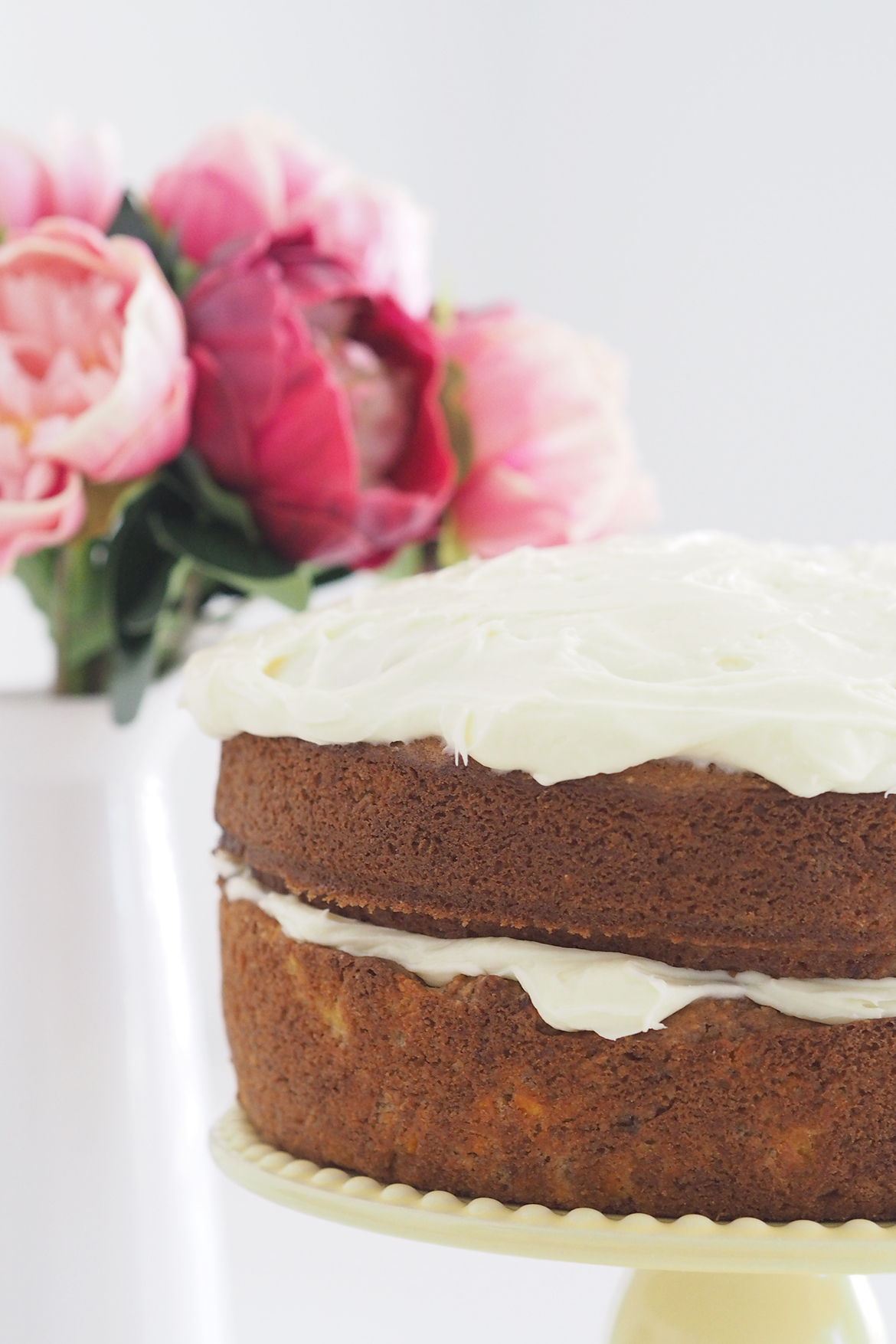 A nutty and very subtle spiced carrot cake, topped with loads of cream cheese icing.