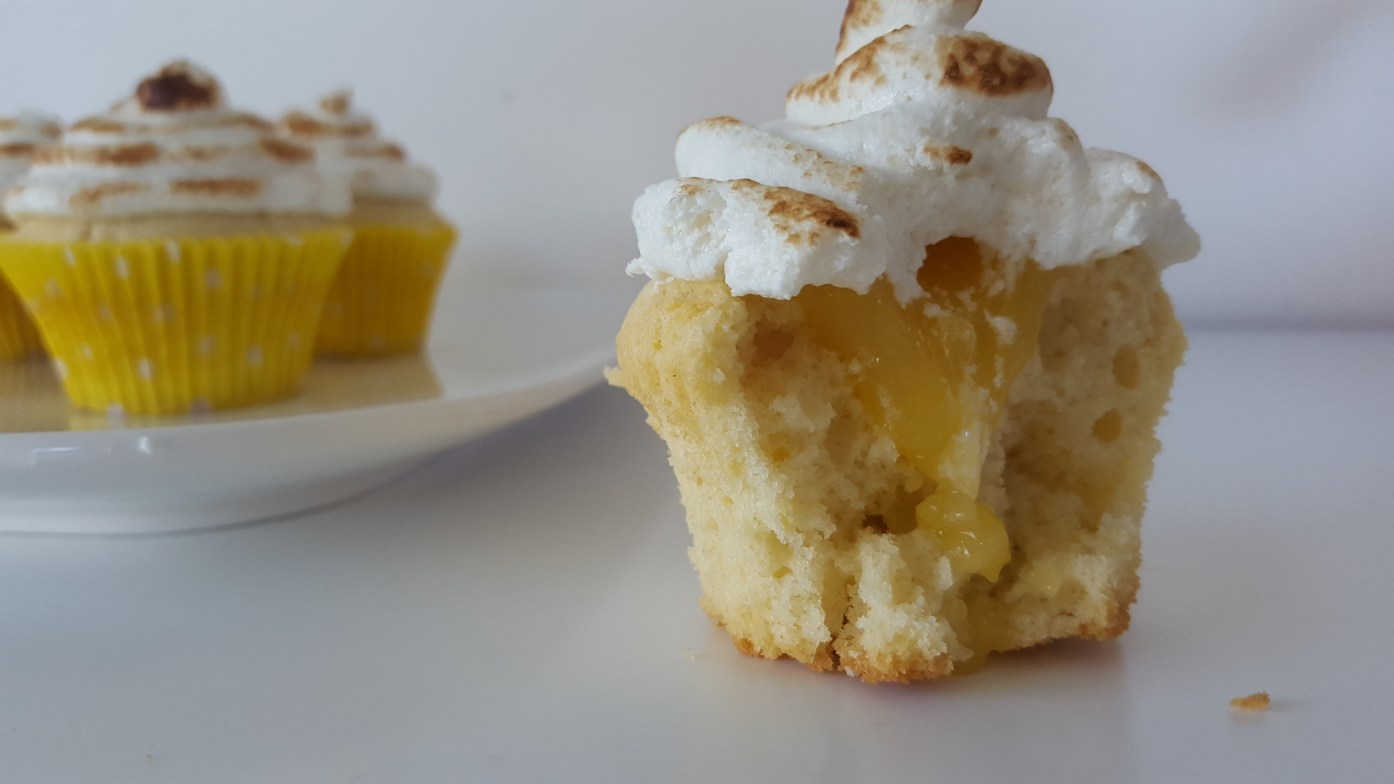 LEMON MERINGUE CUPCAKES - Think light lemon cupcakes filled with lemon curd and topped with a swirl of toasted meringue. If that thought delights you then you need this Lemon meringue cupcakes recipe.