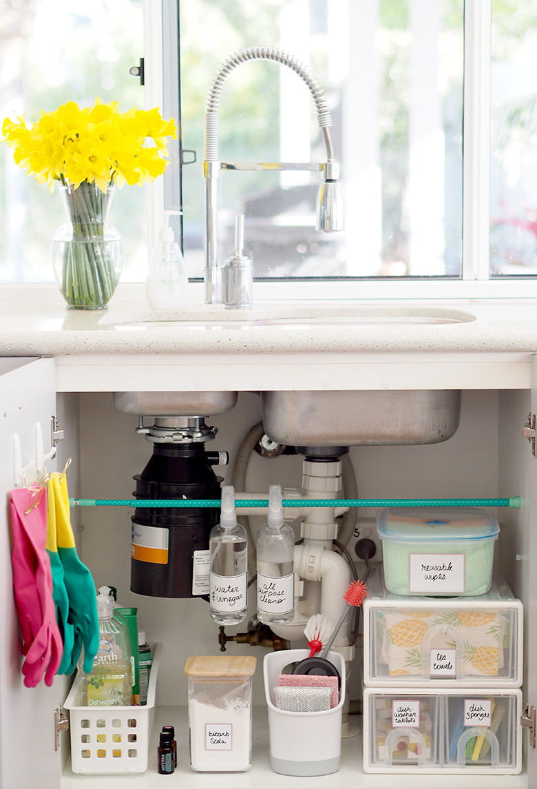 Organised decluttered kitchen. Ideas for under the sink storage.