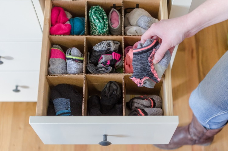 Recycle those cardboard boxes sitting in the garage into one of these awesome ideas - from genius storage solutions to projects for the kids.