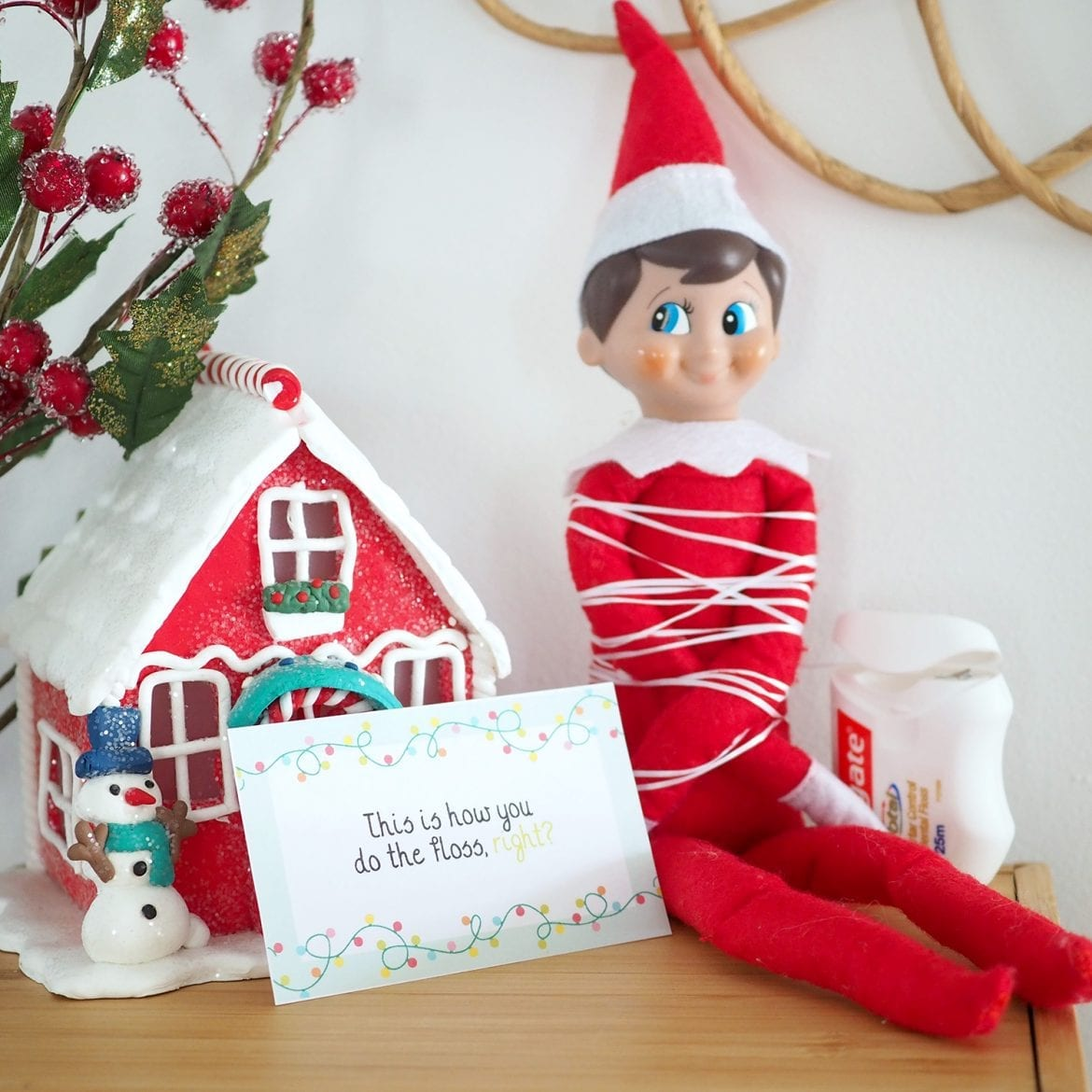 Tooth floss wrapped around Elf on the Shelf