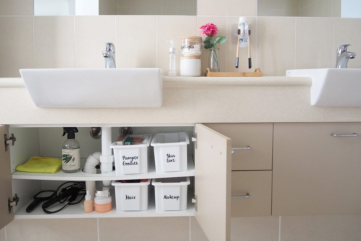Organised and tidy bathroom cupboard clutter free