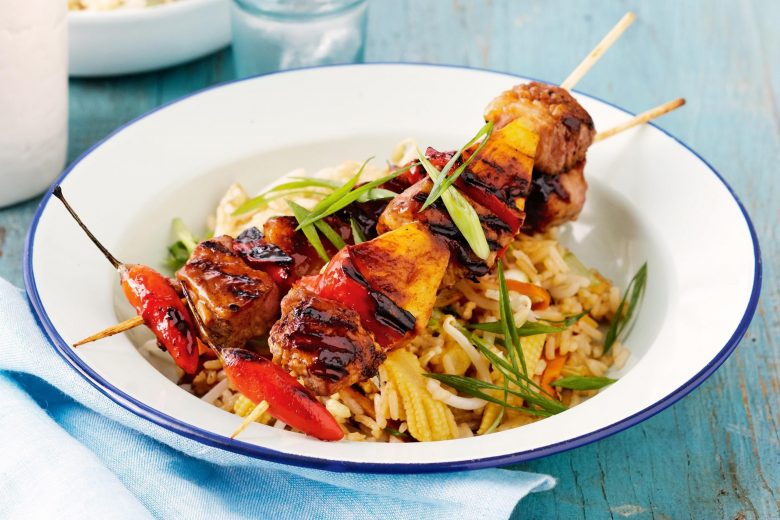 Sweet and sour pork kebabs with fried rice