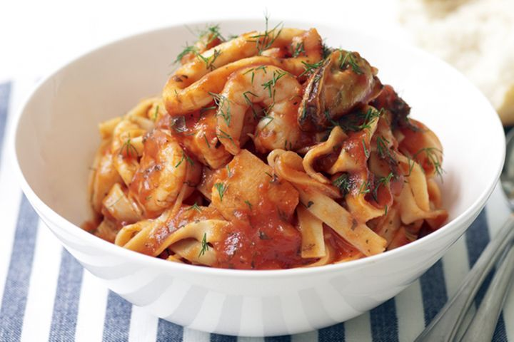 pasta with tomato sauce topped with parsley