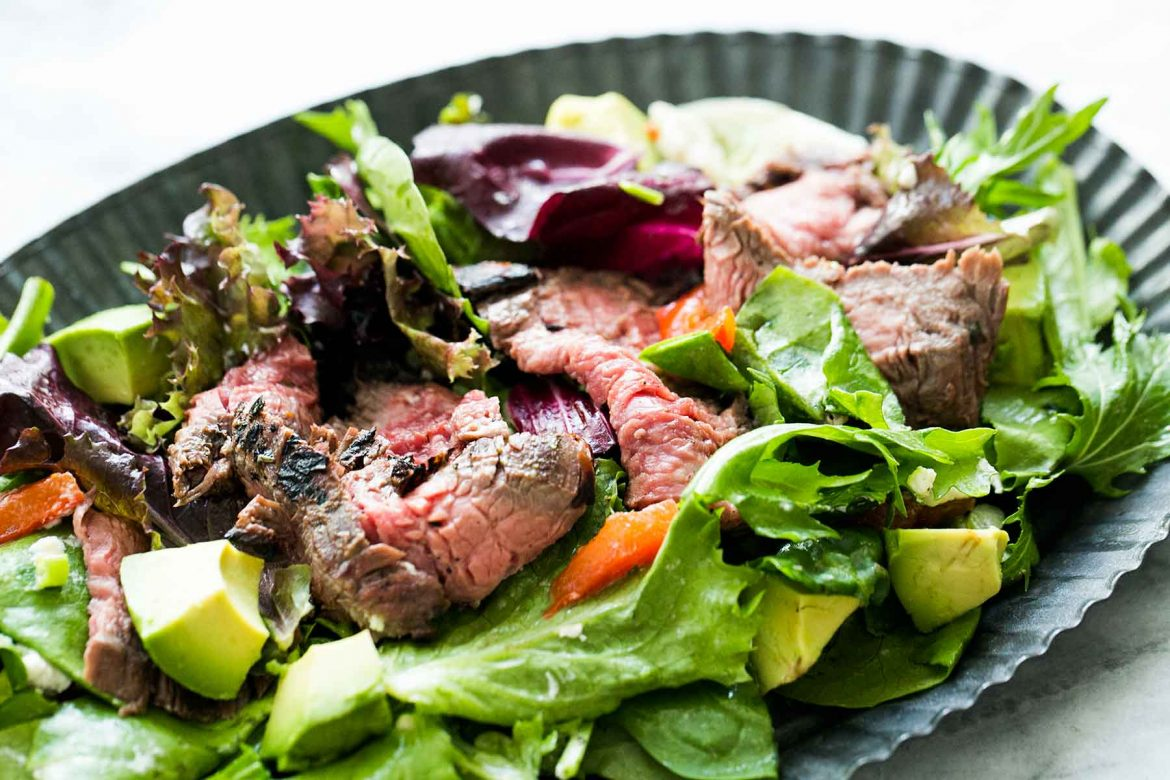 steak and salad with avocado, beetroot and salad