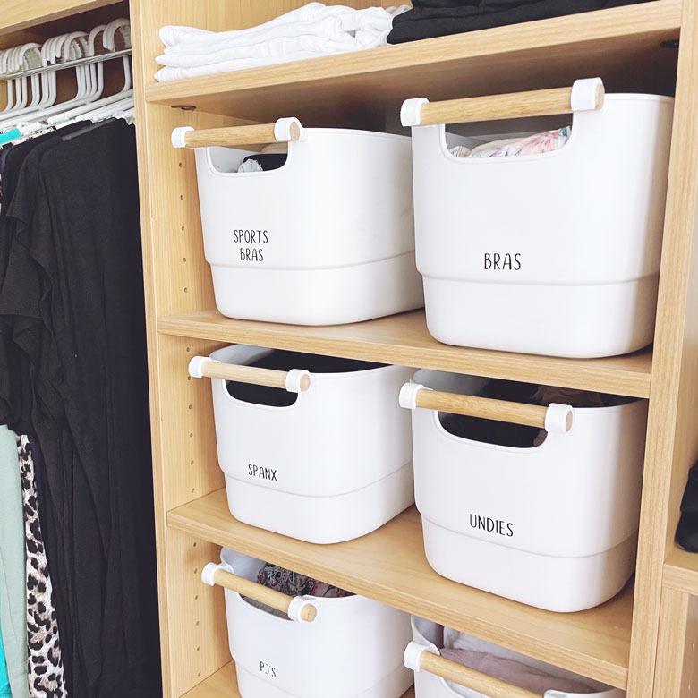 use tubs to organise a wardrobe