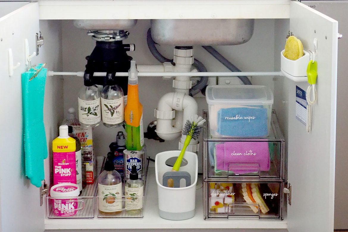 how to organise under the kitchen sink cupboard